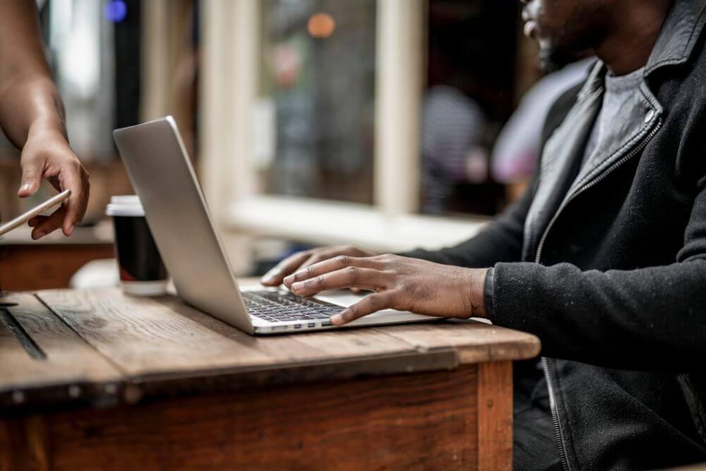 Man typing on laptop at desk
