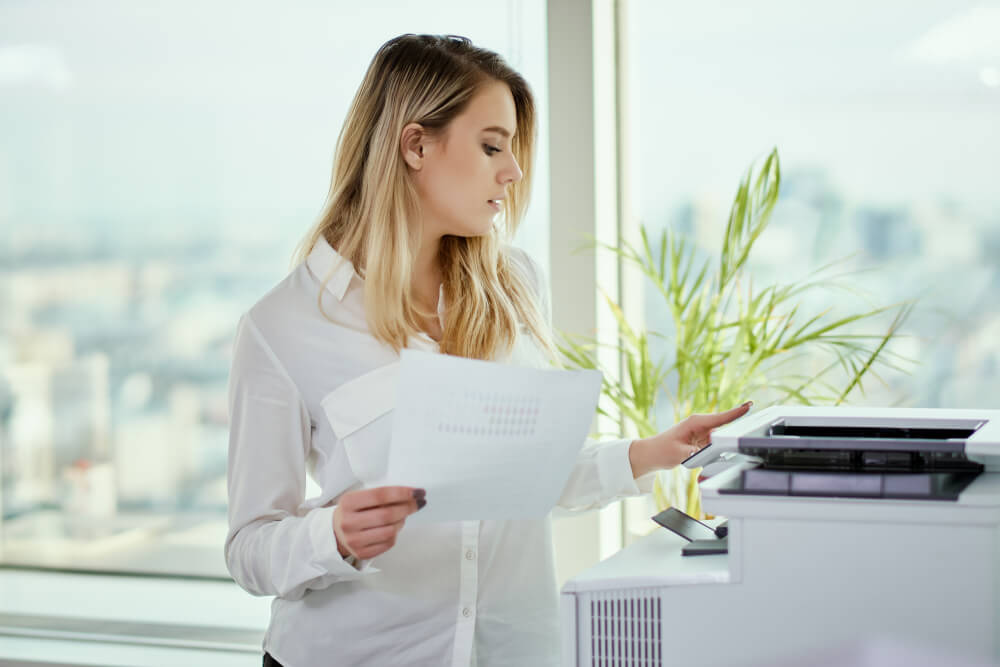 Woman looking at printed paper