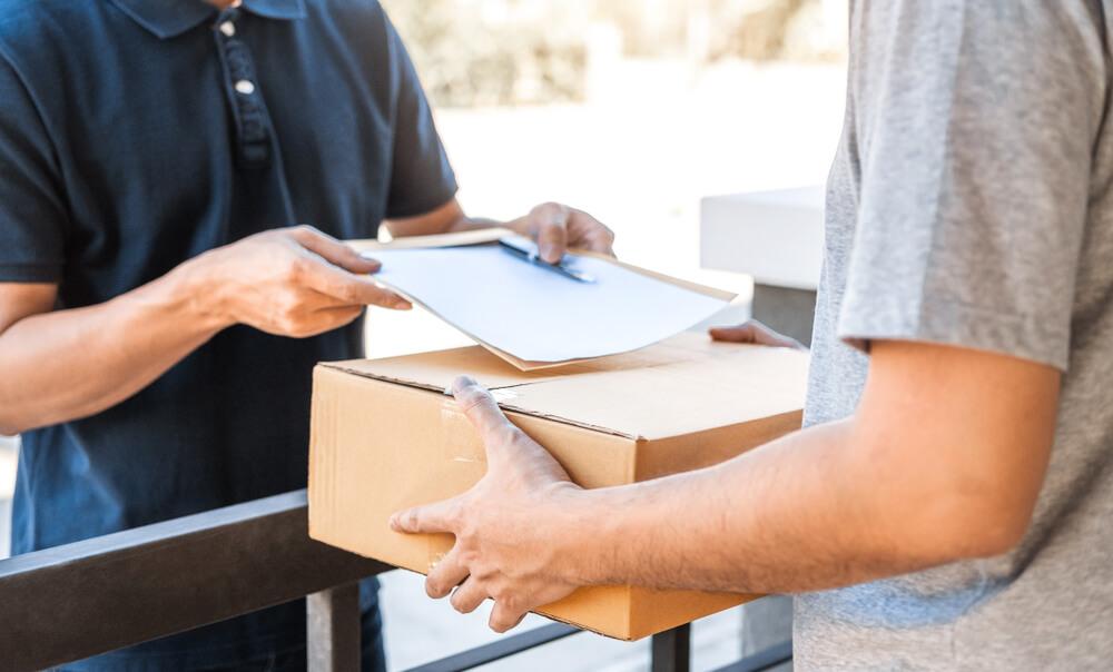 Man receiving parcel delivery