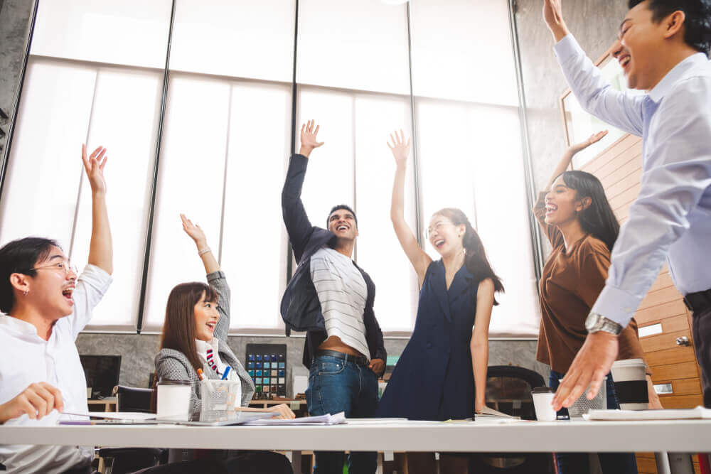 Work team cheering in office