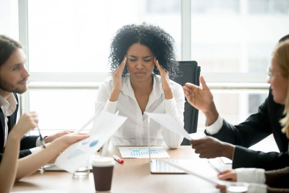 Woman stressed at meeting