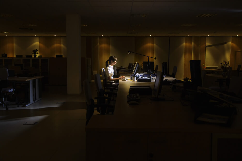 Woman working in office at night