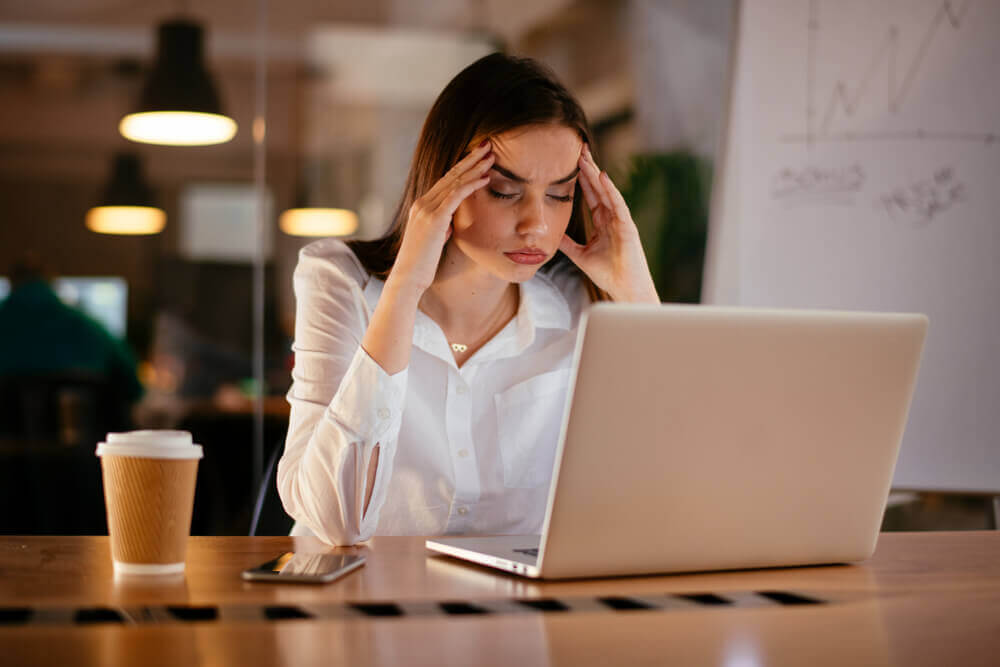 Woman stressed at office desk