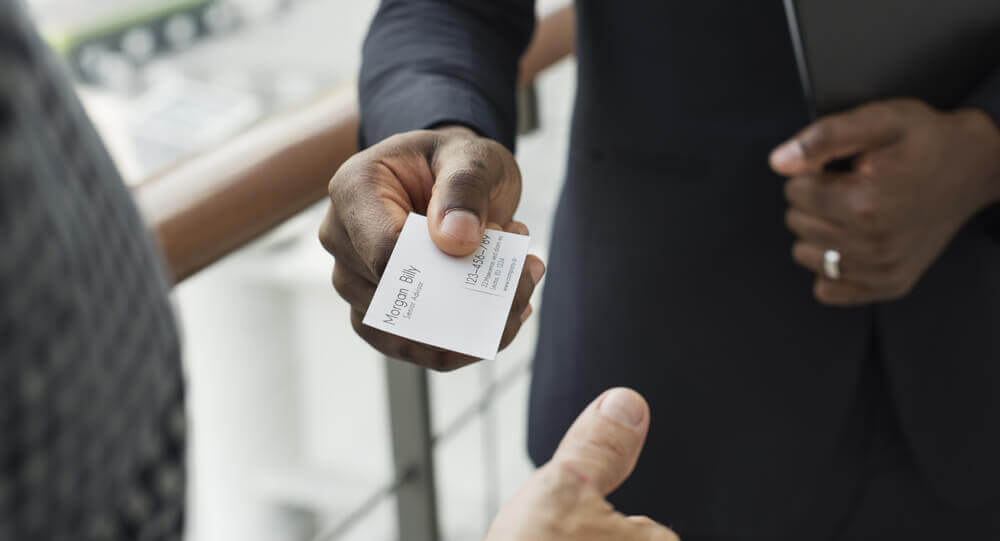 Man handing out business card