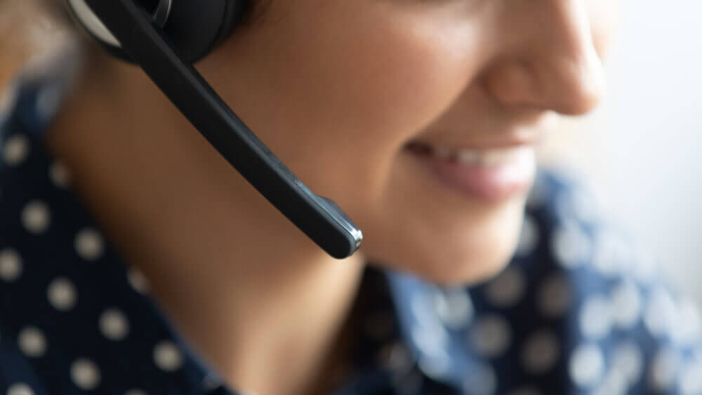 Close-up of woman on headset phone