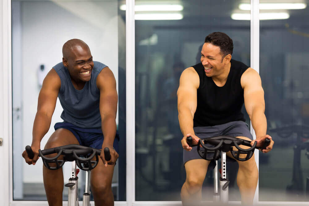 Two men working out at gym