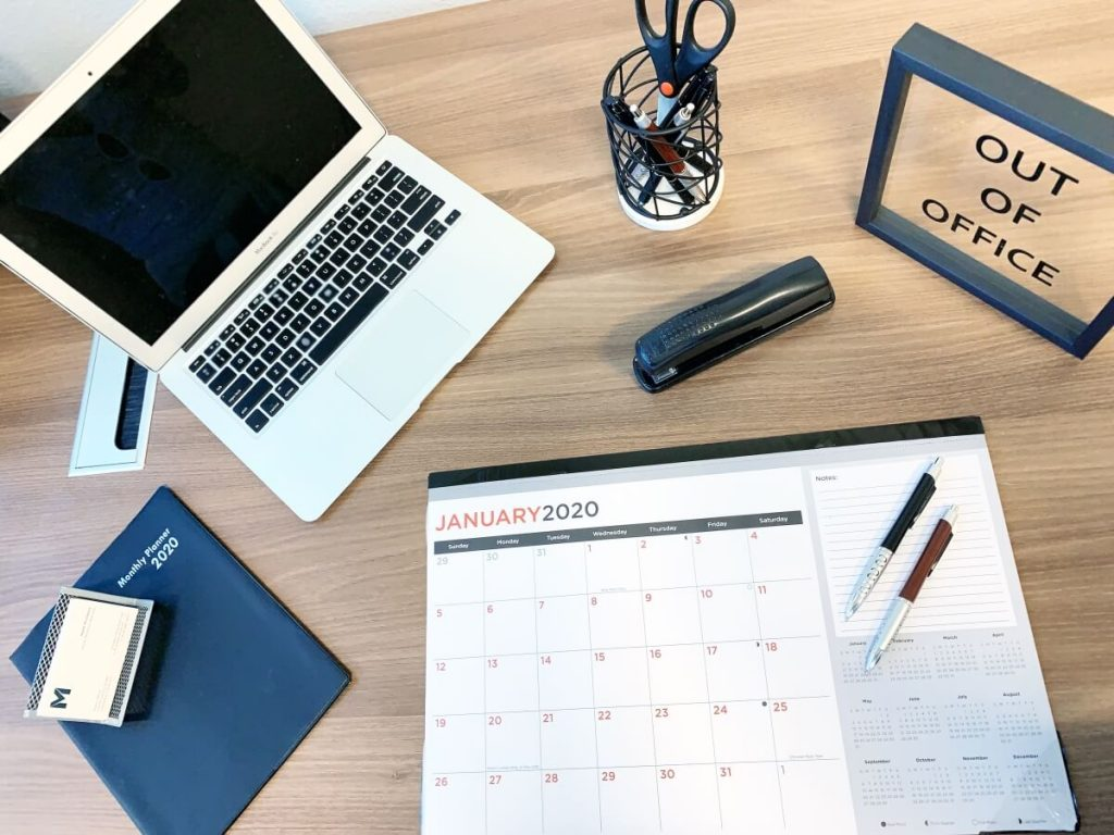 Work desk with laptop and calendar